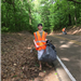 Dalton Shaver helping Marvin and Sharon Johnson clean up DeSoto Rd.