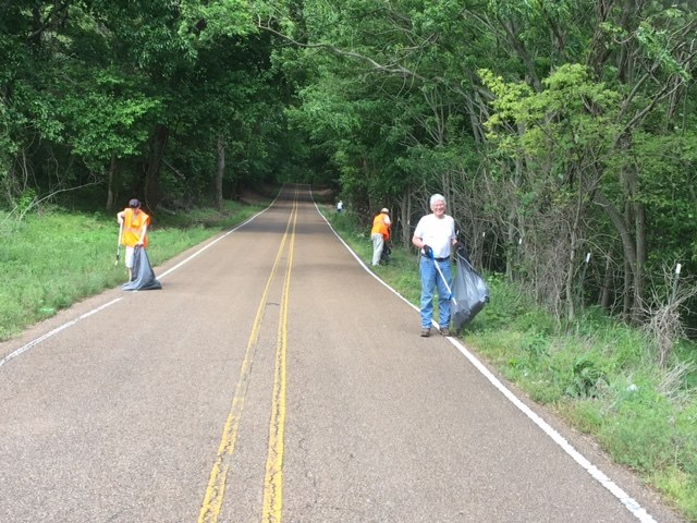 Supervisor Bill Russell's clean-up team led by Marvin Johnson