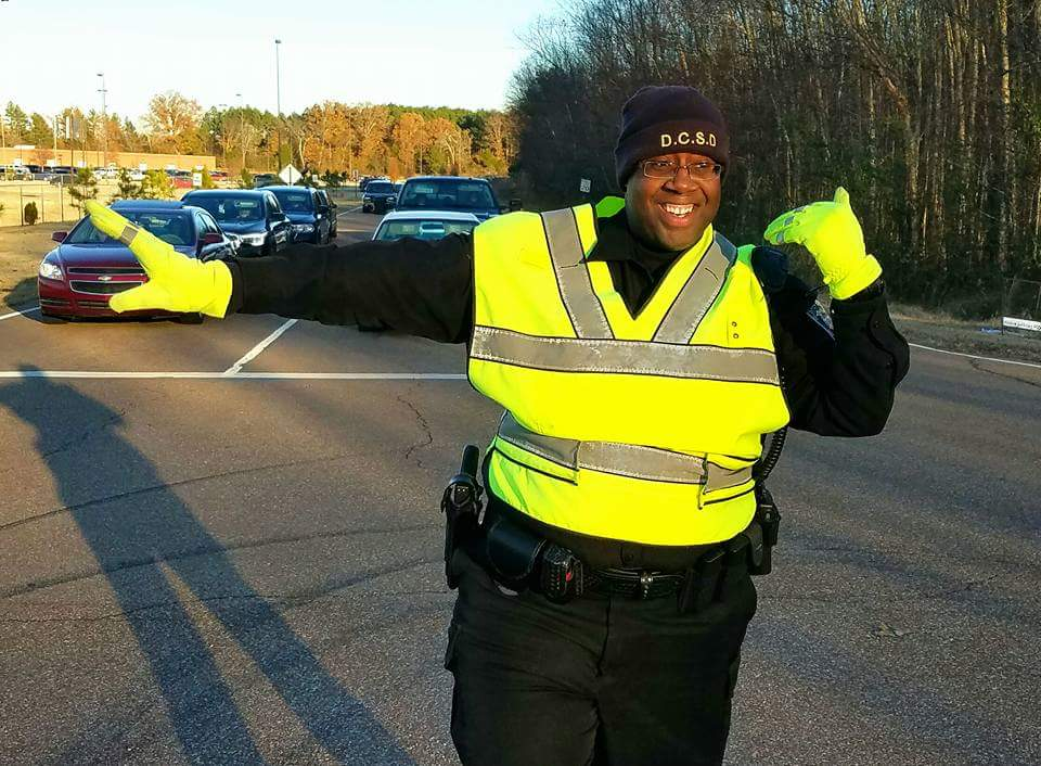 School Resource Officer Directing Traffic